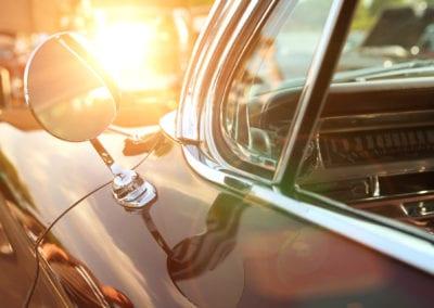 classic retro vintage black car. Car mirror. The car is older than 1985